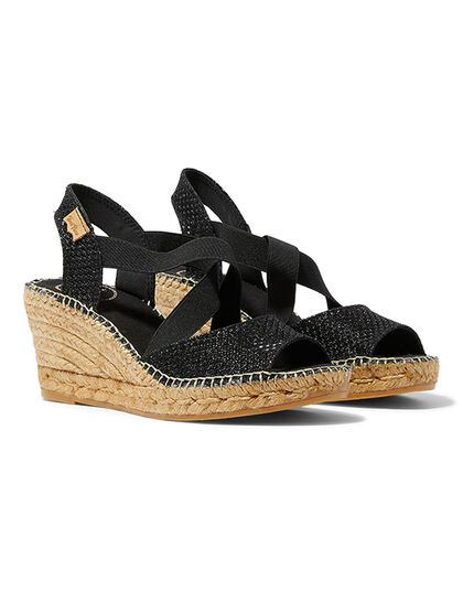 Easy Slip-On With Elastic Straps For A Comfortable Fit The Upper Is Made Of Shimmery Metallic The Fabric Upper Is Hand